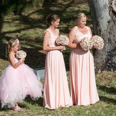 Beautiful Sweet Blush bridal party of gorgeous Eve's countryside wedding 💕 we just adore this soft shade on her bridesmaids in their Goddess By Nature signature ballgowns & her adorable little Flowergirl. 🌸💕  www.goddessbynature.com Stockists & shipping worldwide