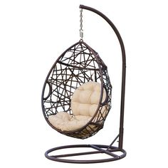 Curl up with your favorite novel and a tall glass of iced tea in this hanging swing chair, showcasing an openwork wicker frame and cushioned interior.