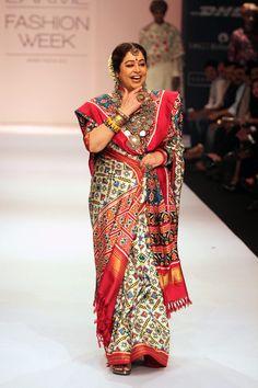 Veteran actress Kirron Kher walks the ramp in a white Patan Patola sari for designer Gaurang at the Lakme Fashion Week Winter-Festive 2013.