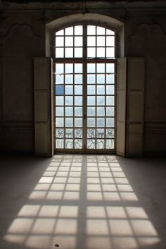 French doors and an arched window. The decaying 18th century historic Chateau Gudanes in the South of France is being restored by its new owners. Limestone, stripped wallpaper, antique doors, shutters, and so much more lovely to explore in this before and after renovation story..