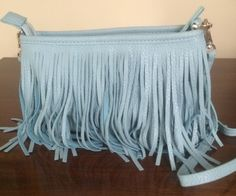 Tuesday Tip: Fringe   Have you bought a fringe purse yet? They are everywhere! I scooped up this fab find at a local Houston boutique called French Cuff. Bonus: it's a beautiful powder blue, which is a trending accessories color this season that I absolutely love! Score one for me. ~ Pat. #asburylane style #fringepurse