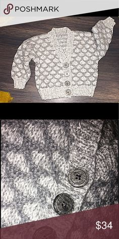 Hand-knit Baby Cardigan for 6 - 9 mos This is an adorable, brand-new baby sweater hand-knitted by my Mom.  She loves to knit baby clothes, but there are no babies in our family!  Rather than let this beauty gather dust, I thought I'd offer it to you!  Nothing more precious than a handmade gift!  Priced is based on materials and creation time, please keep in mind when making your offer.  ❤️ Sweaters Cardigans