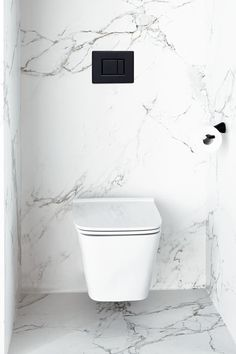 The artful design of the DXV Modulus Wall-Mounted Toilet elegantly adorns this quiet nook. Explore more of Michele Alfano's Modern Copenhagen bathroom. The DXV Modulus Collection is available in November Kitchen Recessed Lighting, Kitchen Ceiling Lights, Kitchen Lighting Fixtures, Ceiling Lighting, Smart Toilet, Rustic Outdoor Decor, Downstairs Toilet, Guest Toilet, Luxury Restaurant