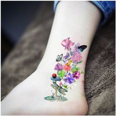 Sweet peas, carnation, butterfly, dragonfly, bumblebee, ladybug, four leaf clover, All my faves.