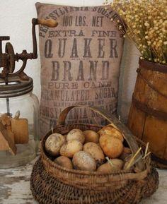 butter churn, sugar sack and potatoes