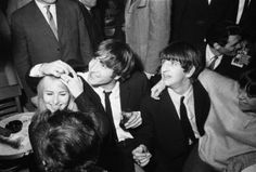 John and Cynthia Lennon At The Peppermint Lounge, USA. John was asked if he was really married, so he is showing Cyn's wedding ring.
