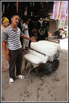 selling ice in Khan el Khalili, major souk in the Islamic district of Cairo, Egypt Life In Egypt, Egypt Today, Cairo Tower, Expo Milano 2015, World Street, Alexandria Egypt, Ice Blocks, Street Vendor, Winter Palace