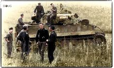 Pz.VI 'Tiger' (Nº123) - 1.sPz.Abt.503 - Operation Citadel near Kursk, Russia - Summer of 1943 From left, foreground: Leutnant Linsser, Hauptfeldwebel Haase, Hauptmann Burmeister and Unteroffizer Lewandowski. The fate of the tank and the crew is unknown. (Colourised by Doug)