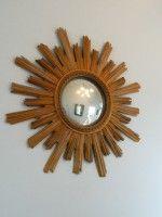 Antique French gilded wooden starburst with convex mirror.  Stunning!
