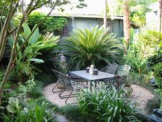 New Orleans Garden Design photo of a traditional courtyard formal garden in new orleans Private Residence In New Orleans Tropical Landscape New Orleans Peter Raarup Landscape