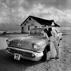 ♬''' Chris Spedding, 1976, Camber Sands Chris Spedding was one of the top session guitarists in the UK when he recorded as a solo artist in his own right for Micky Most's RAK label. This shot of Chris with my 1957 Oldsmobile Super 88 was taken at Camber Sands for the single Jump In My Car. I also made my first (and almost my last!) promo film for this record!. :) .'''♬ http://www.mankowitz.com/?s=chris+spedding