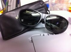 Solitaire Fit over sunglass fits over prescription eyeglass or wear as a plano sunglass Black frame grey polarized lenses These are great around water
