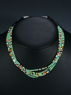 """Native American Indian Jewelry Santo Domingo Necklace By Doreen Calavaza Stones: Jet, Apple Coral, Shell, Serpentine, and Turquoise Size: 18"""" in total length Suggested Retail $365.00 / Your Price: $297.00"""