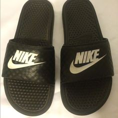 Mens NIKE slides size 9 Excellent gently worn condition- shoe slight sign of wear but are clean and look new on .they are men's 9 but I feel they run small . I am a woman's 9 and length fits me . Nike  Shoes Sandals