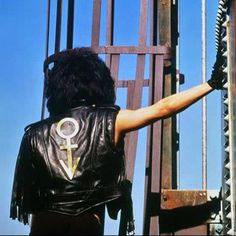 Prince - Graffiti Bridge Era 1990, notice Love Symbol on the back of jacket.