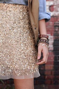 sparkles...this could be cute for a'snazzy casual' event. Like the denim and vest. Add boots