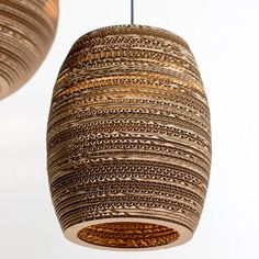 Beehive shaped hanging lampshade made from recycled cardboard -therefore light but strong and the layers of cardboard look like wood The Beehive
