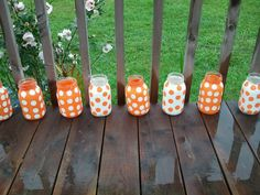 Painted Mason Jars:) im gonna do this for halloween and ill let everyone know how it turns out! you can also use a little candle to stick in there :)