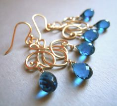 These sweet peacock blue quartz faceted teardrop briolettes are wrapped in gold filled wire and placed with ornate gold plated chandeliers. They are shown with french 14k plated ear wires.  The entire earring is roughly 2 inches in length. Lightweight and very pretty. Your earrings will arrive beautifully gift boxed.