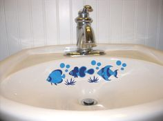 A cute tropical fish decal for the bathroom sink, toilet, tiles or shower doors.