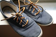 Blue Vans with leather laces.