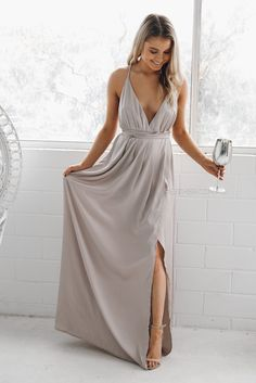 The Rourke Maxi Dress in Silver features a plunging neckline with open back detail, lace-up halter neck, and full maxi silhouette. The Ideal bridesmaids dress. fit: standard sizing, relaxed style, light weight fabric, unlined, halter neckline, plunged neckline, open back, side slit, pull on style colour:silver fabric:100% polyester length: approx. 117cm from waist to hemline our model is 163cm tall and is pictured in a size 8/S