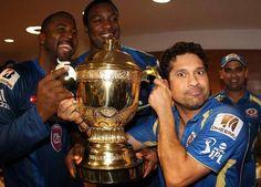 Dwayne Smith, Kieron Pollard and Sachin Tendulkar hold the IPL trophy.