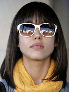 shoulder length hair with bangs. Can't pull off those sunglasses though :p