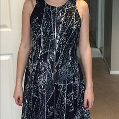 Fun Dress With Zipper in the front Really soft and flowy.96% polyester and 5% spandex. Mossimo Supply Co Dresses