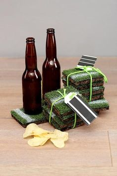 completed diy astro turf coasters wrapped, pictured with beer bottles