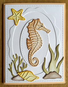 Amazing texture using our Soft Finish Cardstock! This card was created with Josest Designs' Seahorse, Seaweed, and Shells Small. The background was made with Els van de Burgt Studio's Stitched Ovals, Stitched Rectangles, and Fitted Frames 4 Curvy Ovals. Find the products here: https://www.elizabethcraftdesigns.com/.