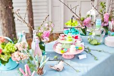 #confettimagspring  Pastel table setting with branches and florals. Perfect setting for a spring party!
