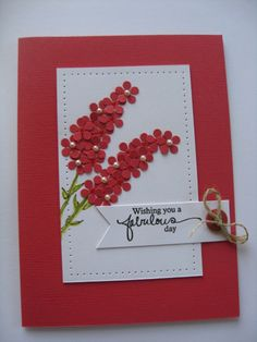 handcrafted birthday card ... red base and red punched little flowers forming  lilac-like stems .... sweet little pearls ... piercing ... button and twine ... great card!