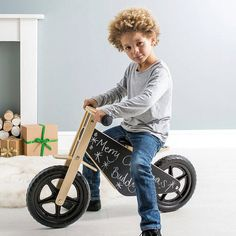 www.Grattify.com  Ideal first bike with a chalkboard finish that's capable of nurturing creative expression to personalise the balance bike to your little ones taste!  This simple chalkboard bike is perfect for little riders to develop their skills. It comes complete with multi coloured chalk to allow your little ones to draw on the body of the bike, a padded seat for comfort, easy to grip handlebars perfect for little hands and hard wearing wheels that never go flat!  Balance Bikes are a…
