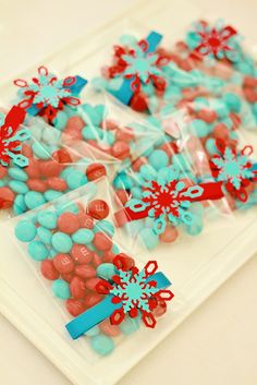 Fun fa-la-la favors! - Christmas M & M's or even Tic Tacs... adorn with little color-coordinating snowflakes and there's an added bonus of an ornament! - a sweet little somethin'-somethin' for giveaway gifts!