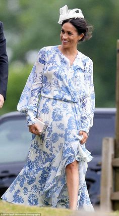 Newlywed Meghan looked stylish in a draped blue and white dress for the occasion