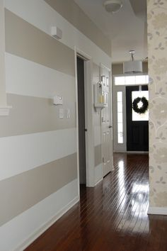 horizontal striped hallway with coordinating  wallpaper