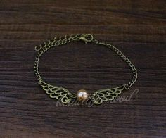 The Golden Snitch Bracelet by beautifulmood on Etsy