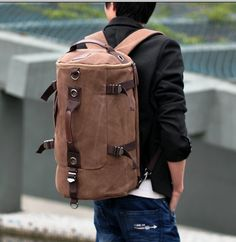 """Canvas roll style Backpack...you may be saying to yourself...""""Dude...what's with the bags?"""" Well I have been without a decent overnight bag for a while now.  In fact I have been known to rock an Eyerore suitcase to the DJ Convention.  It lacks style...I an digging the canvas..time for an upgrade."""
