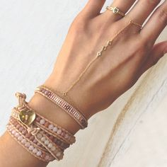 Wrap bracelets and ring by Chan Luu.