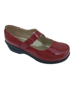 This Red Patent Dannis Mary Jane is perfect! This shoe is not leather.  It is comfortable enough but it would be better in leather.