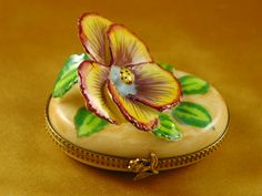 http://www.limogesfactory.com/limoges-boxes-and-figurines/pansy---yellow-P4695.html Pansy - yellow