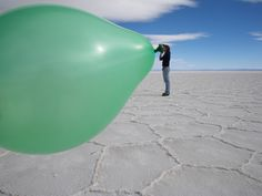 I'm going to try this one at the next party I go to. (Everyone will be SO impressed with my BIG balloon blowing lungs) Forced perspective.