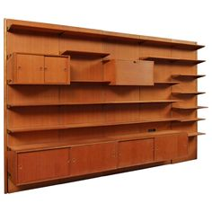 Oregon Pine Storage Wall by Finn Juhl | From a unique collection of antique and modern shelves at https://www.1stdibs.com/furniture/storage-case-pieces/shelves/