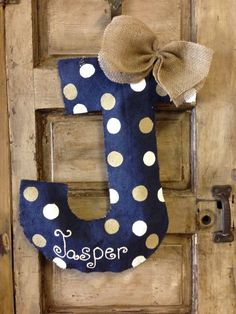 This is a custom initial door hanger made of burlap, fabric (coordinated with colors of your choice), wire/twine (you pick) hanger for hanging, and
