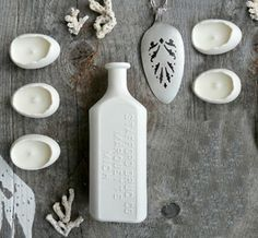 Love this porcelain bottle vase.  It's the perfect nod to vintage but it's also white.  I love white stuff!  :)