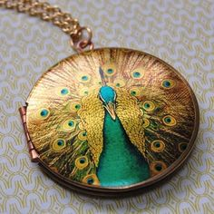 Gorgeous peacock locket.