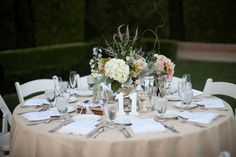 Pretty pastel wedding table with rustic florals - Bridal Musings Wedding Blog   Photo credit: Melissa McClure Photography