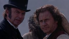 Alistair Stewart (Sam Neill) - George Baines (Harvey Keitel)
