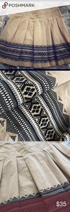 Ann Taylor LOFT Skirt Tan color with a black and cream Aztec/tribal design at the bottom. Design is on front, back and sides of Skirt. 100% cotton but has the feel of a velvety/corduroy material. No stains or rips. Ann Taylor Skirts